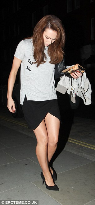 Legs galore: The pretty star flashed her toned legs to perfection as she arrived at the London restaurant