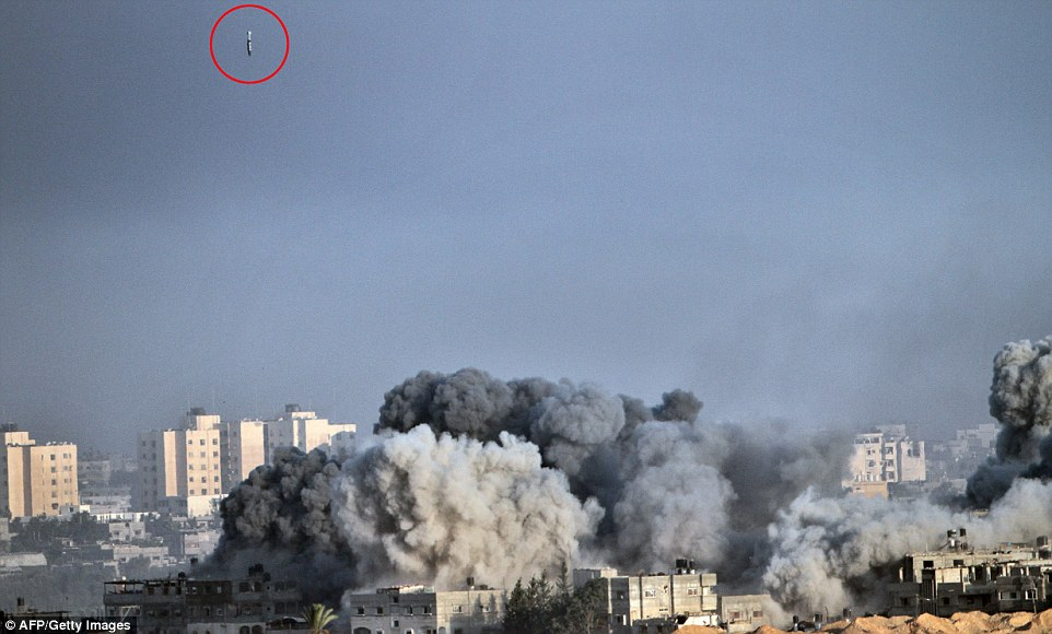 War begins again: Israeli air strikes resumed on the 20th day of the conflict after the military said Palestinian militants had fired several rockets at southern Israel. Pictured: A bomb is seen dropping onto an area of Gaza city this morning as black smoke from others rises into the air. A new 24-hour truce has been agreed