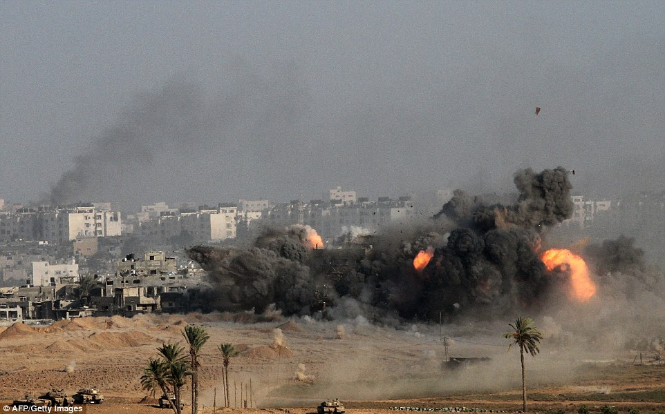Destruction: Black smoke and fireballs once again littered the Gaza City skyline this morning. The conflict has claimed more than 1,500 Palestinian lives in 20 days