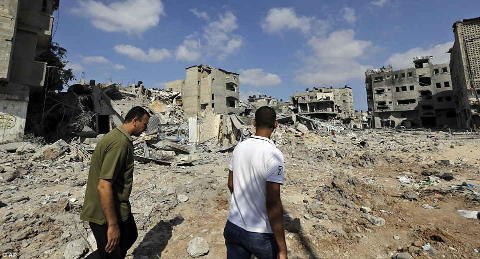 Surveying the damage: Parts of Beit Hanoun, in the northern Gaza Strip, have been reduced to a warzone landscape with nothing but burnt-out buildings and rubble
