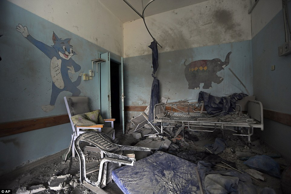 Poignant: Damage from air strikes on a children's ward at a hospital in Beit Hanoun, with cartoon characters still painted on the blackened, dirt-strewn walls