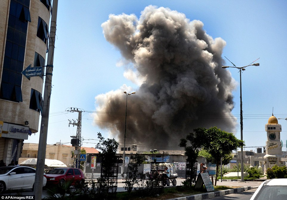 Carnage: Smoke rises over Gaza City today after Israel's Prime Minister accused Hamas of violating its own attempt at a second truce in the conflict