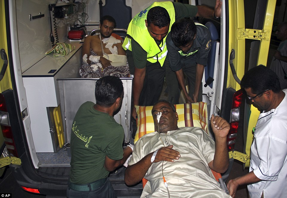 Injuries: Palestinians are prepared to be moved by ambulance from a hospital in north Sinai to Cairo after they crossed the border between Gaza and Egypt yesterday