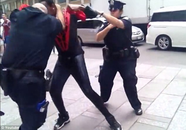 Dressed as Spider-Man, 25-year-old Times Square entertainer Junior Bishop goes in -- and lands -- a punch against a New York City cop
