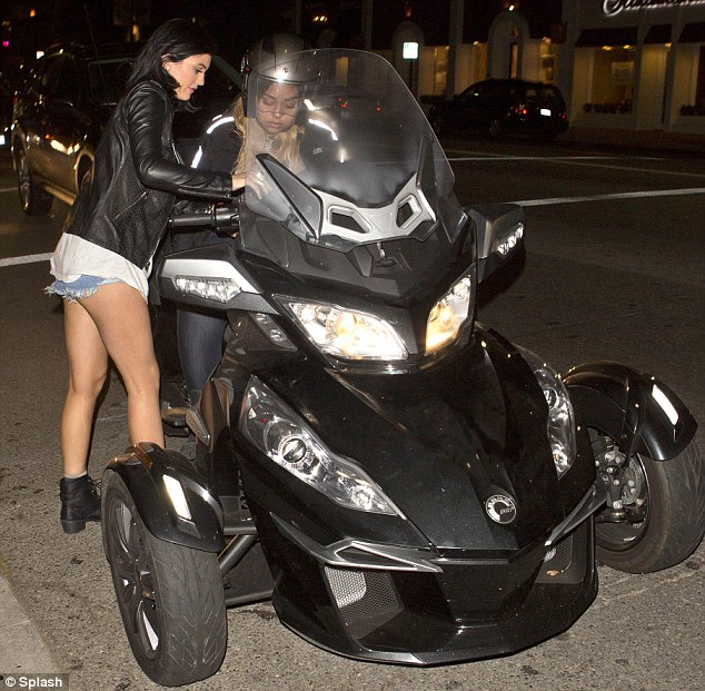 Wacky ride: Kylie Jenner drove a friend to dinner in West Hollywood on the back of her three-wheeled Can-Am motorbike on Friday