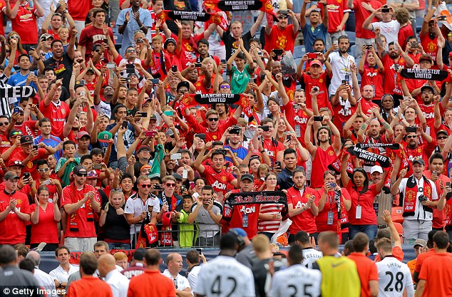 Popular: Manchester United continue to pack stadiums wherever they travel in the world