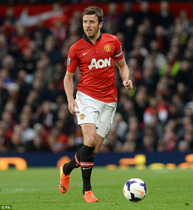 Setback: Midfielder Michael Carrick has been ruled out for the next three months with an ankle injury