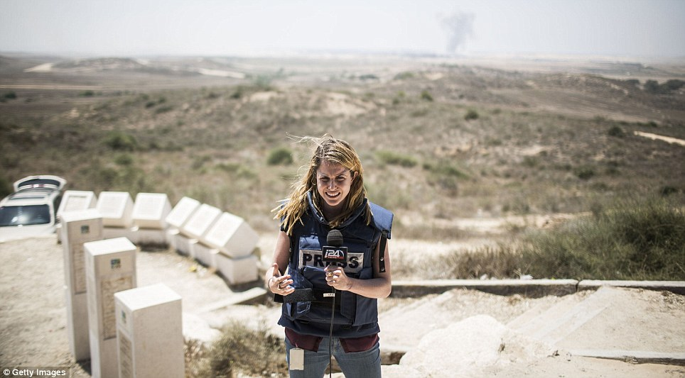 On the ground: A TV reporter does a broadcast as the 24 hour ceasefire began