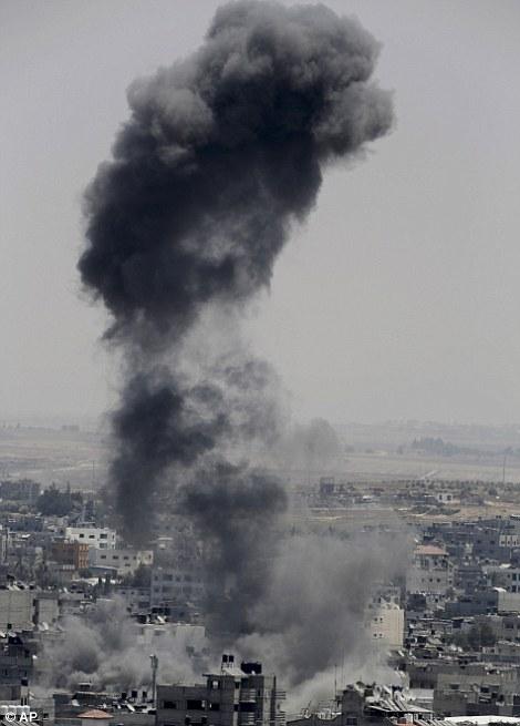 Smoke from an Israeli strike rises over Gaza City in the northern Gaza Strip