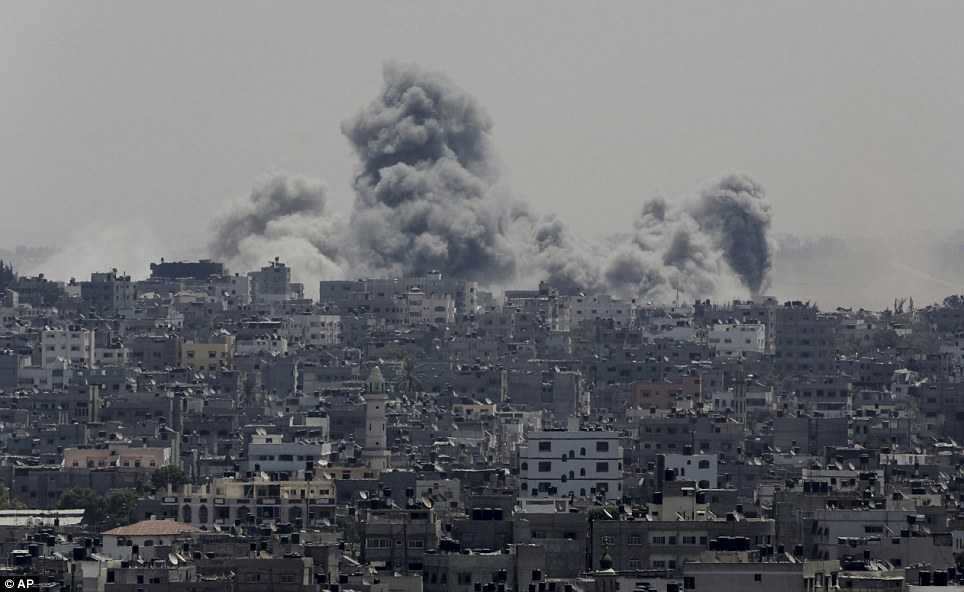 Wrath: Smoke from Israeli strikes rises over Gaza City in the northern Gaza Strip today. An agreed ceasefire lies in ruins today, with attacks from both sides