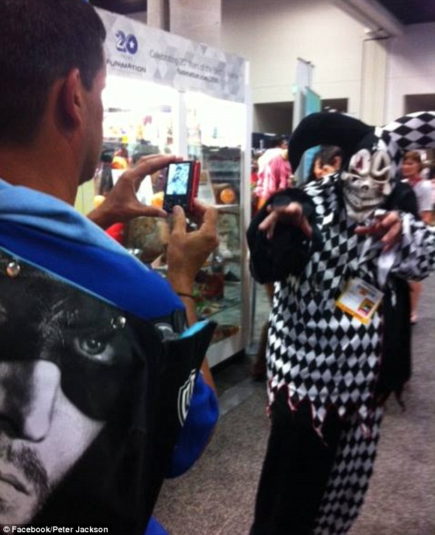 Blissfully unaware! A fan takes a photo, impressed by the Jester costume - not knowing Peter was behind it