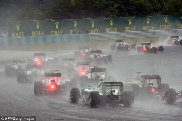Treacherous: The wet weather in Hungary played havoc with the team's strategies in the early stages of the race