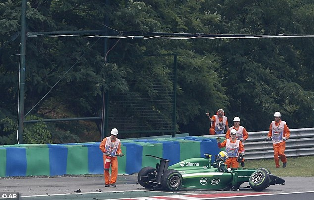 Shunt: Marcus Ericsson ended up in the barriers after losing control of his Caterham on the exit of Turn 3