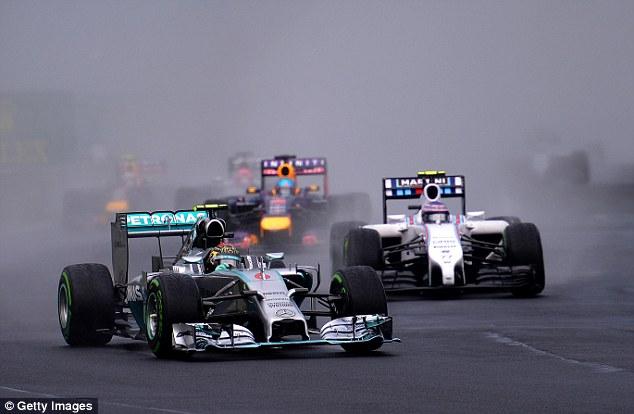 Setting the pace: Nico Rosberg leads Valtteri Bottas and Sebastian Vettel into the second corner at the Hungaroring