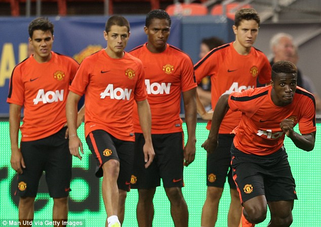 Put through his paces: Wilfried Zaha (right) was forced to do a double warm down session after United's win