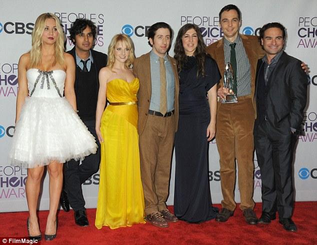 Season 8 coming soon: Cuoco, along with Big Bang Theory co-stars Kunal Nayyar, Melissa Rauch, Simon Helberg, Mayim Bialik, Jim Parsons and Johnny Galecki pose together at the 2013 People's Choice Awards