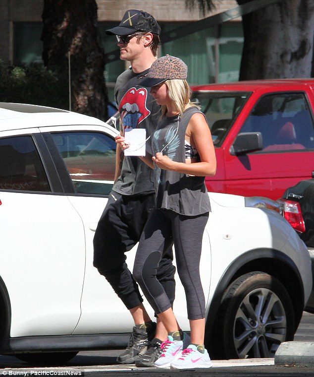 Pre-marital bliss: Ashley and fiance Christopher French were spotted out for a walk in Los Angeles on Saturday