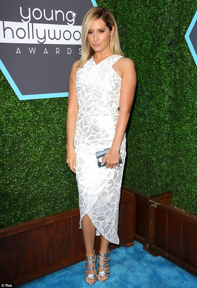Bride-to-be: On Sunday evening the Ashley Tisdale teased a look in all-white while attending the Young Hollywood Awards in a shimmering white dress adorned with a pretty silver feather pattern