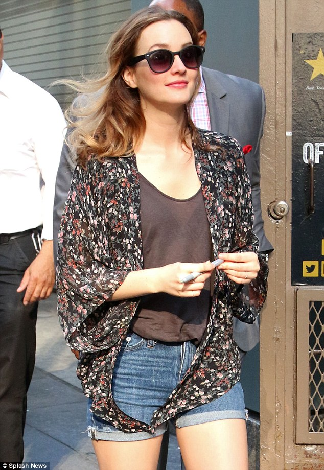 Summer chic: The former Gossip Girl star paired her shorts with a sheer brown blouse and floral cardigan