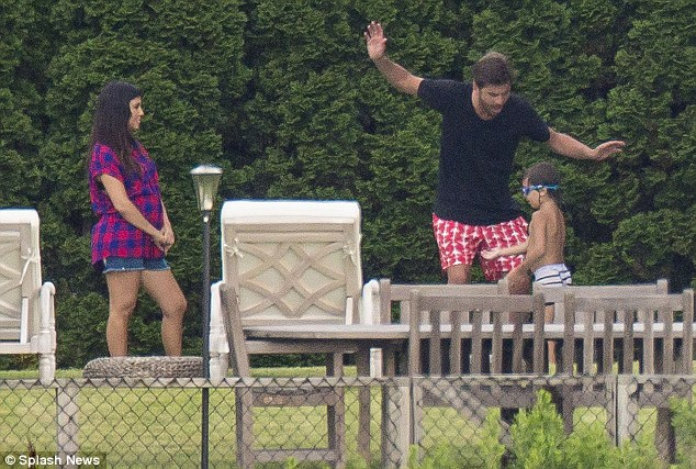 Monkeying around: Scott has a laugh with his son as Kourtney looks on from the sidelines