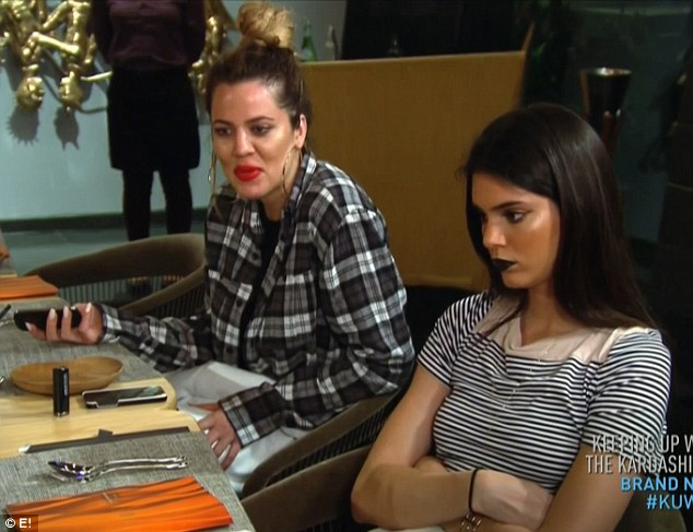 Sister fight: Kendall crossed her arms and kept quiet as Khloe and Kim argued