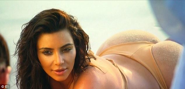 Bikini-clad: Kim seductively poses on the beach in Thailand