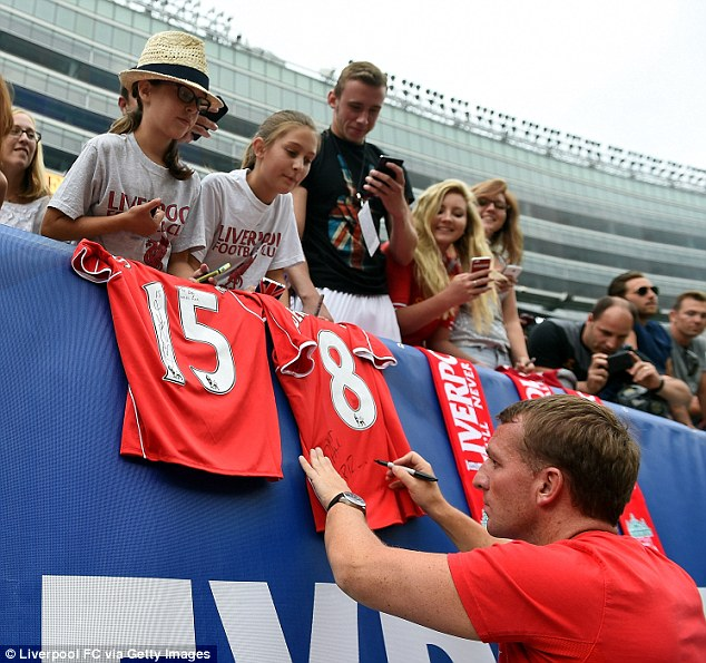 Meet and greet: Rodgers signs autographs for some of Liverpool's American-based fans as they played Olympiacos in Chicago