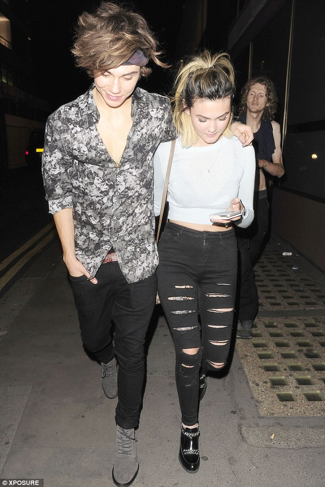 Cheeky chappie: George couldn't help smiling as he was pictured with the Neon Jungle star