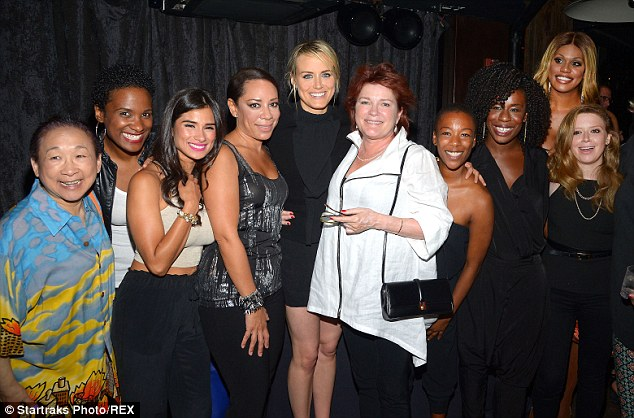 Instant party: The Orange Is The New Black star's cast mates joined her to celebrate. Pictured (L-R) Lori Tan Chinn, Vicky Jeudy, Diane Guerrero, Selenis Leyva, Taylor, Kate Mulgrew, Samira Wiley, Uzo Aduba, Laverne Cox and Natasha Lyonne