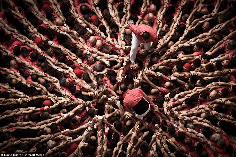 Climbing: The attempts are assessed by a panel of seven judges, who are said by competition organisers to be 'experts on the human towers'
