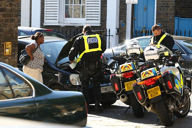 The minders called in armed officers after becoming concerned and the woman's keys were confiscated and her Toyota Yaris searched (pictured). It was then decided the car would be towed away from the scene