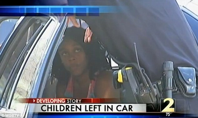 Mother: Mosley, pictured, is interviewed by a police officer on the scene
