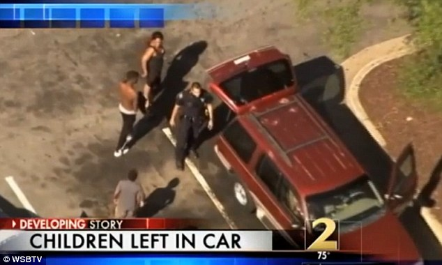 Hot car: The Atlanta mother-of-four has been charged with reckless conduct after she left all her children in a hot SUV, pictured, while she went grocery shopping, police say
