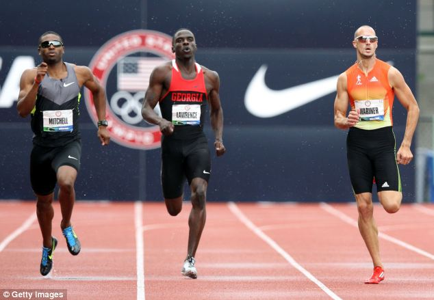 Strong: Lawrence, center, set school records and came 9th in the U.S. Outdoor Championships in June