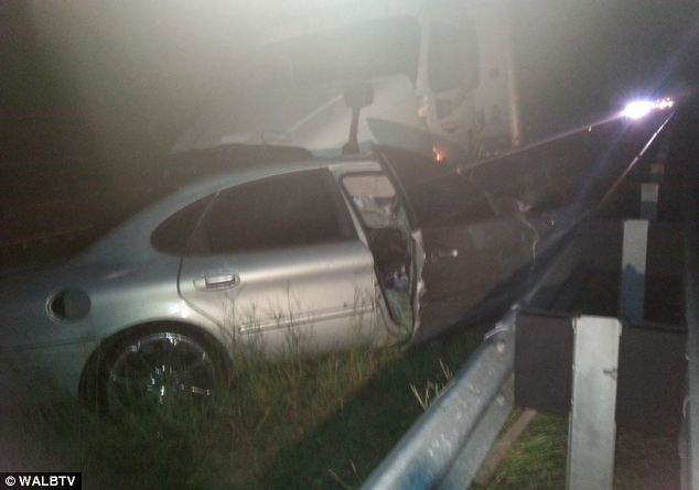 Freak accident: He had climbed out of his car to call 911 but a semi hit it, causing the vehicle to hit Lawrence