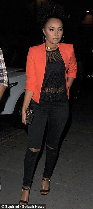 In the mix: Singer Leigh-Anne was hard to miss thanks to her vibrant cropped jacket