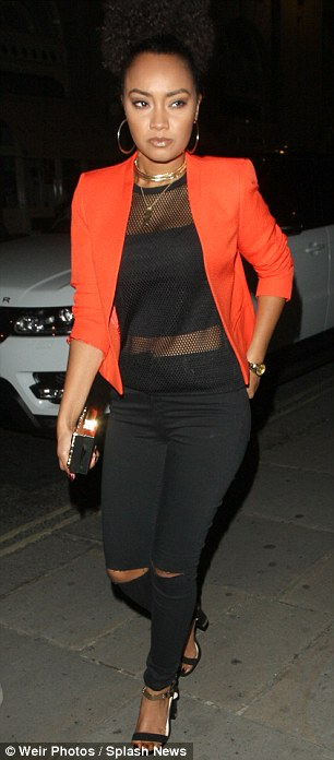 ... while bandmate Leigh-Anne Pinnock wore a cropped orange blazer jacket, fishnet semi-sheer top and ripped skinny jeans