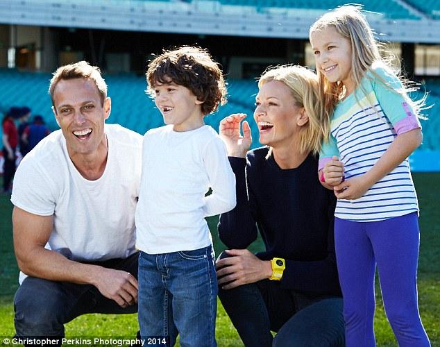 Young at heart: Sarah posed with Fox Sports presenter Matt Shirvington, and young fans Noah Tesorieo, seven, and Hannah Watkins, eight
