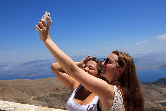 Addicted: Around 89 per cent of respondents admitted that they took their mobile phone abroad on holiday with them on their last trip