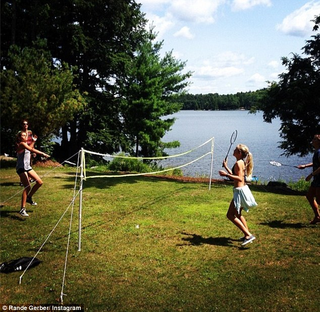 Fun and games: Both Cindy and Rande have been busy posting snaps of their summer vacation that included this playful game of paddle tennis