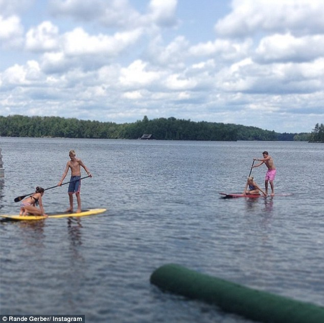 Lake placid: Presley, Kaia and friends enjoyed an afternoon of paddleboarding on the seemingly calm blue waters of the lake