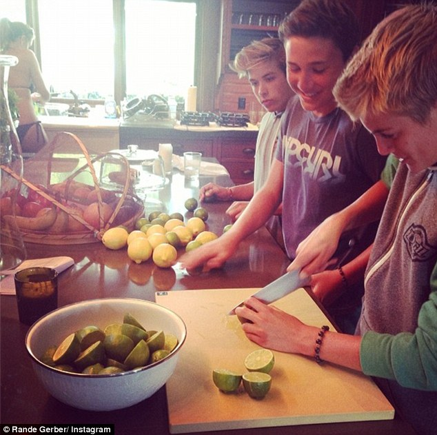 Margarita time: Presley helped to make refreshing margaritas for his parents by slicing some limes with friends in the cosy kitchen