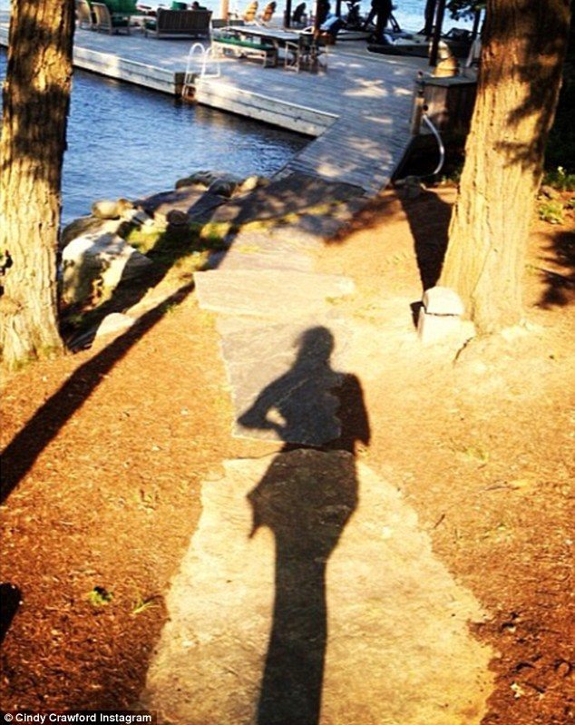 'Lake life!' Cindy's willowy figure appeared in shadow in this picturesque snap that included a glimpse of the comfortably furnished dock