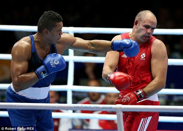 Left hook: Joseph Joyce (blue vest) of England fighting Ross Henderson (red vest) of Scotland on Tuesday