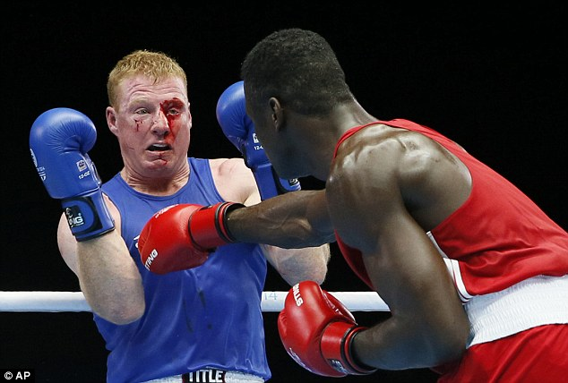 Punch: Efe Ajagba of Nigeria (right) and Paul Schafer of South Africa (left). The bout today was stopped due to the injury on Schafer's face