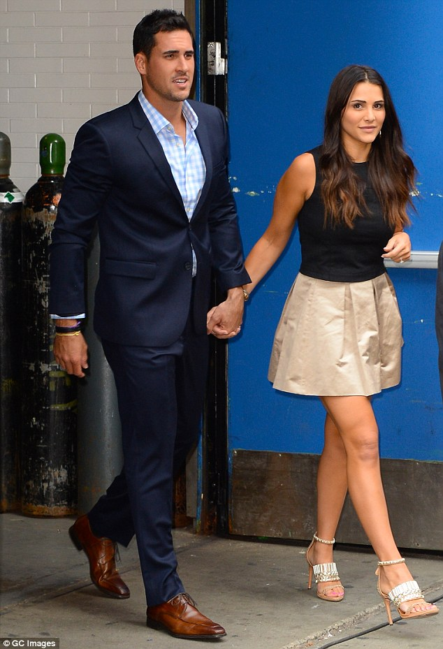 Hand in hand: Andi wore a flirty gold skirt, black tank top and gold heels as she walked out of their Good Morning America taping on Tuesday