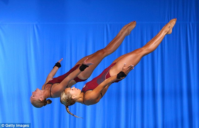 Perfection: The English pair plunge towards the pool from the high board