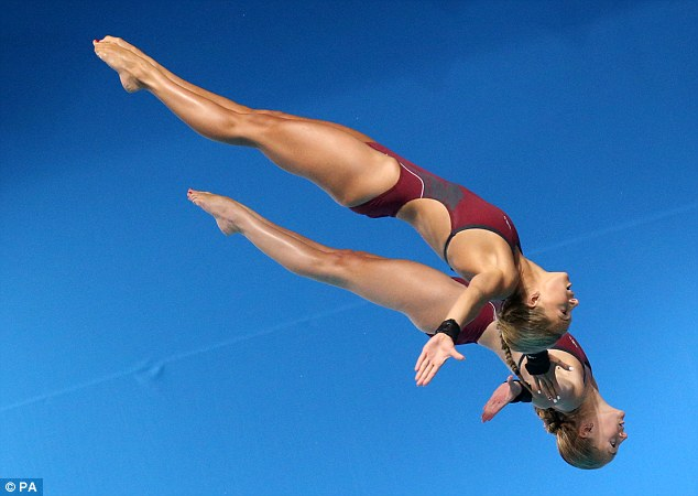 Beautiful dive: Tonia Couch (top) and Sarah Barrow perform a perfectly synchronised dive in Edinburgh