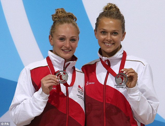 All smiles: The two English girls celebrate their silver medals despite just missing out on the top prize