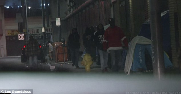 Ominous start: Shanks Rajendran took it upon himself to travel to Skid Row and begin filming - much to the anger of these men approaching his car